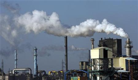Smoke flows from the Fertiberia factory in Huelva, southern Spain